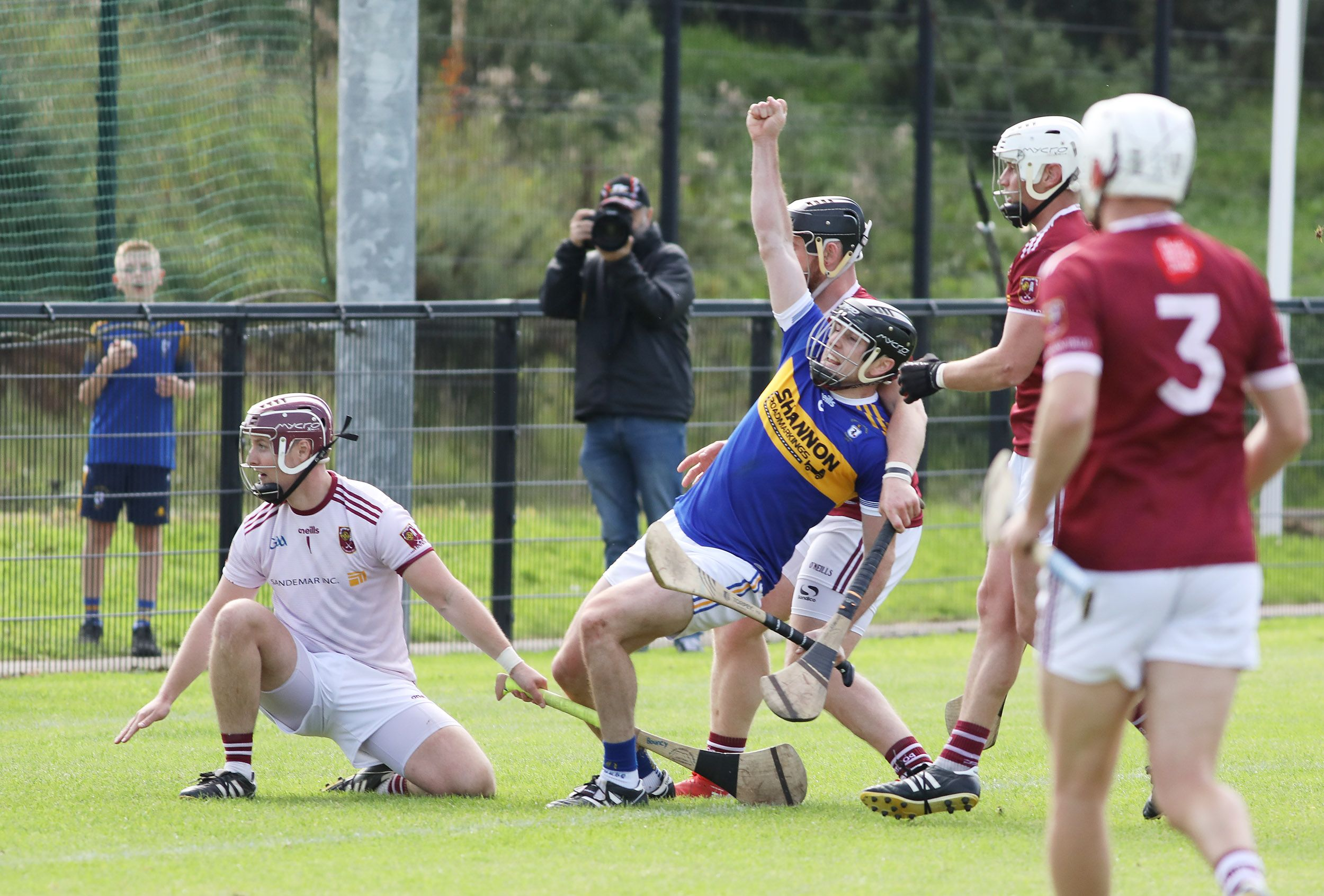 Michael Armstrong kicks home his second goal during Rossa\'s victory over Cushendall