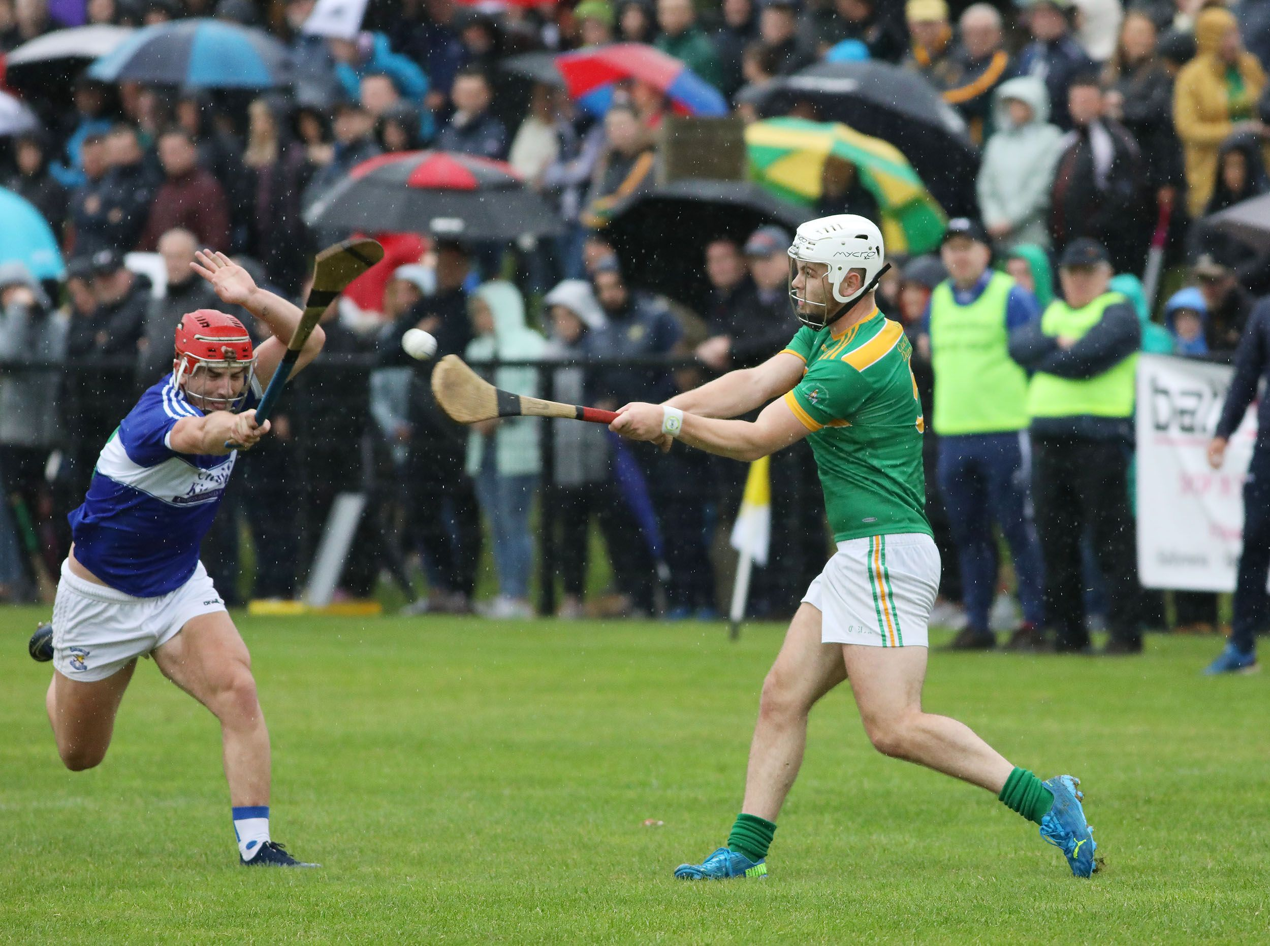 Ronan Molloy gets the ball away as Michael Bradley closes in