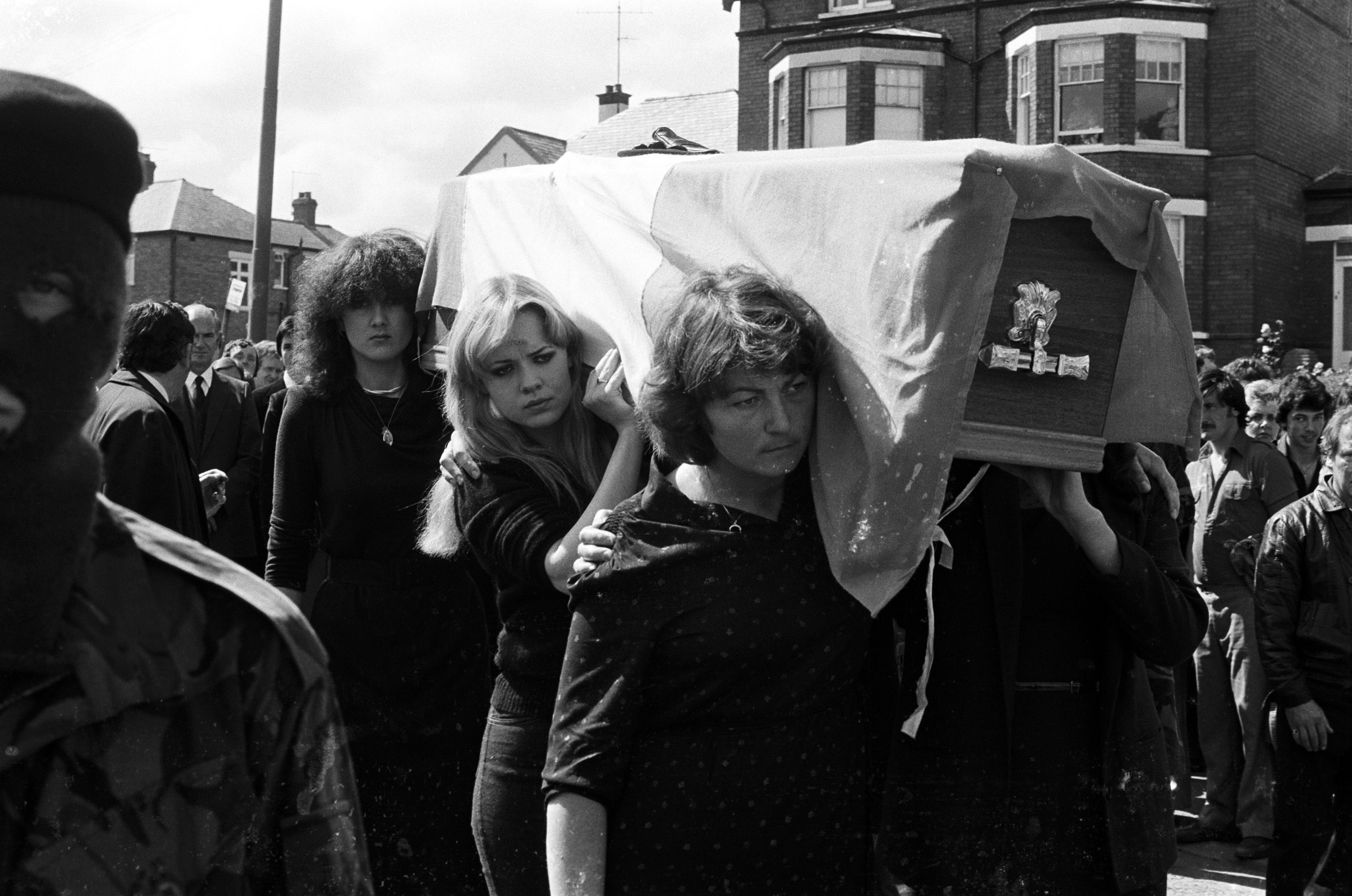 FINAL JOURNEY: Kieran's sisters Mairéad and Siobhán McKenna and sister-in-law Betty Doherty carrying his coffin on the way to Milltown Cemetery
