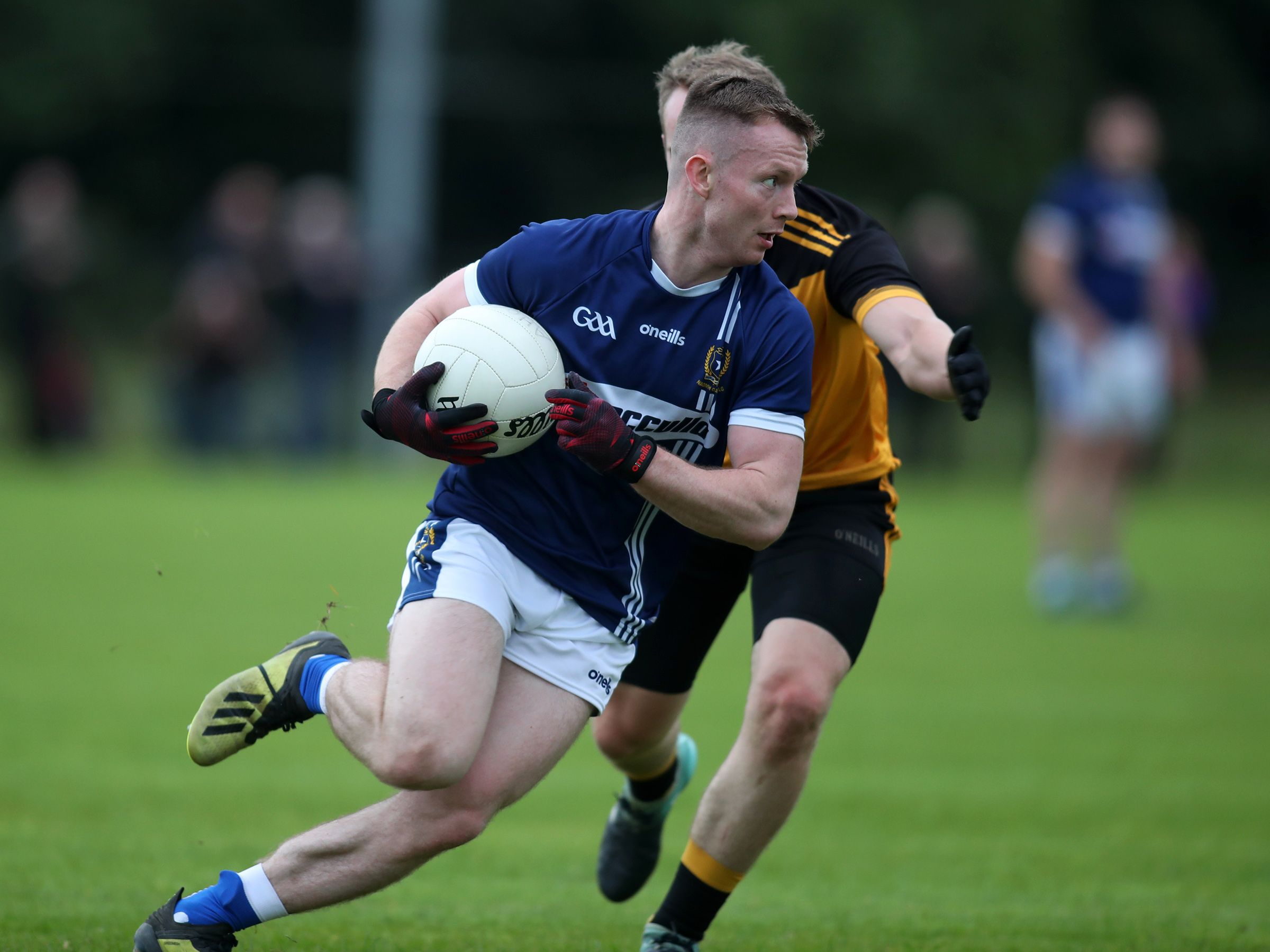 St Gall's defender John McCaffrey in action