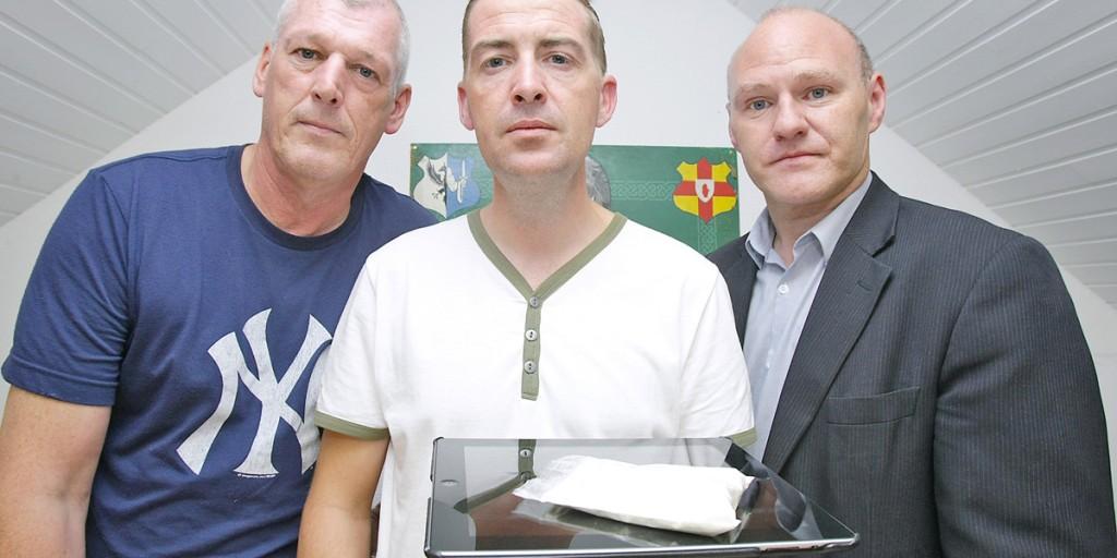 Cllr Matt Garrett, Benny Lynch and West Belfast MP Paul Maskey with the drugs