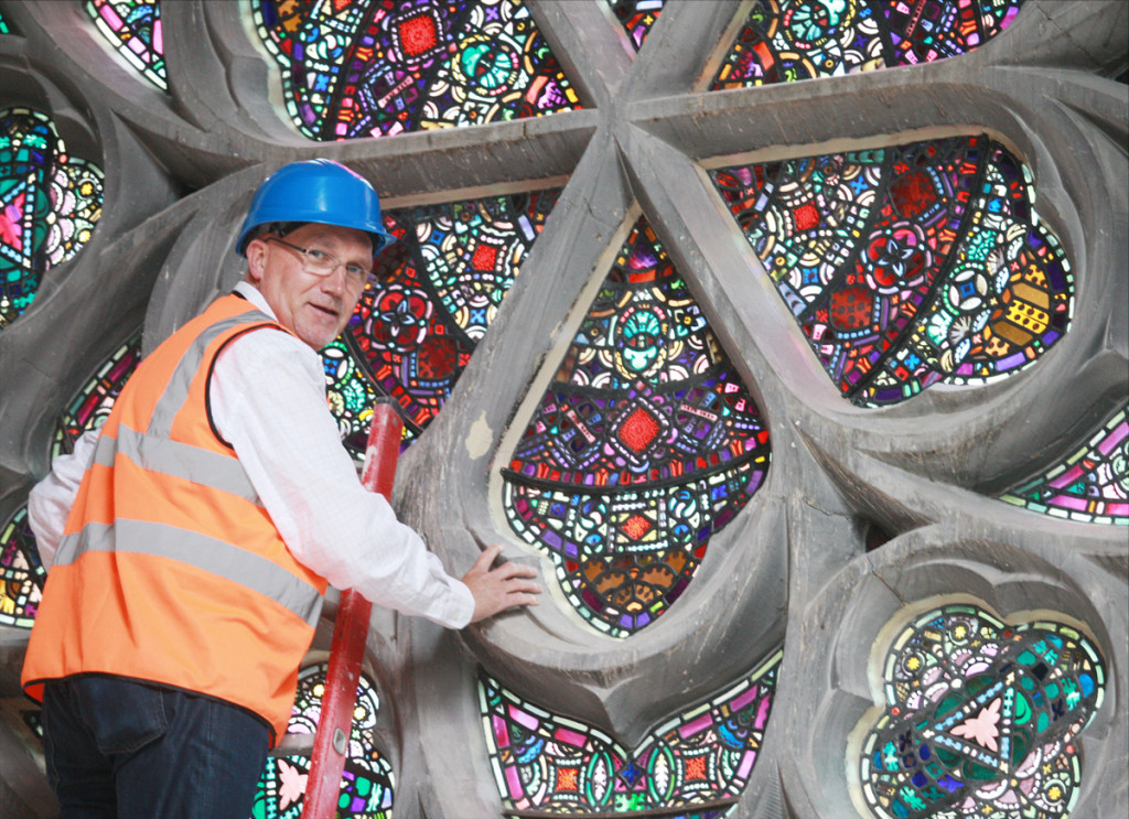 Rev Bill Shaw at the Duncairn Centre window that so intrigued a visitor