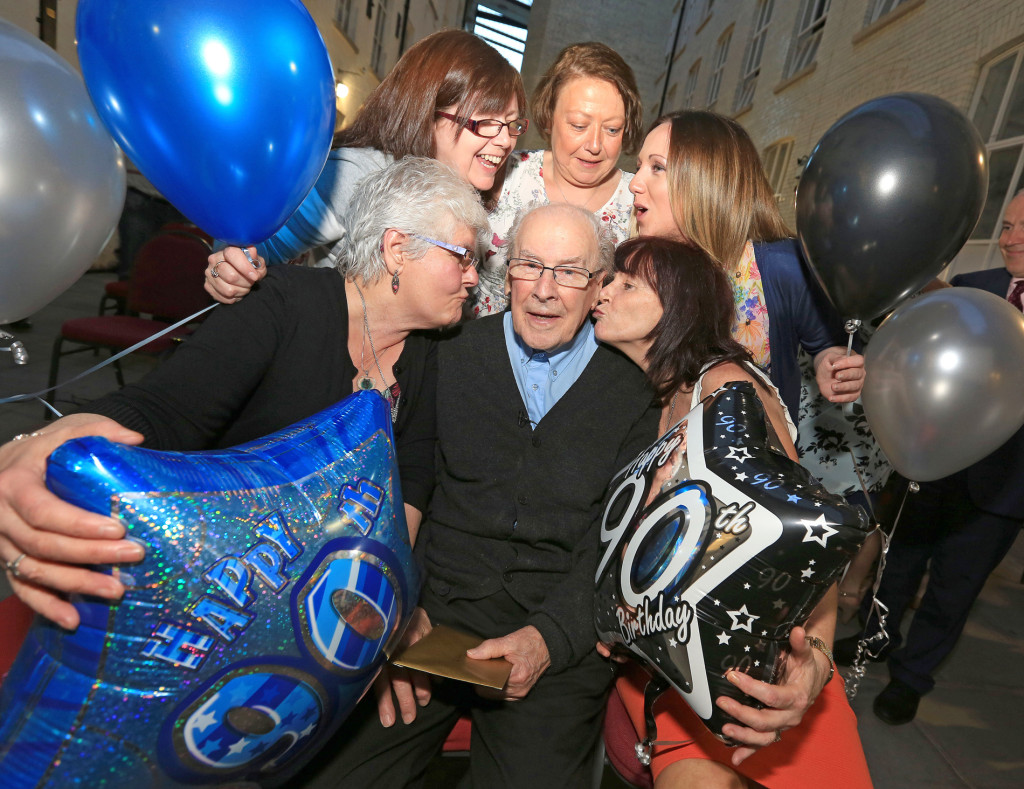 Fr Des celebrates his 90th with the 'Conway Millies': Elsie Best, Janet Donnelly, Brenda Kelly, Fiona Murray and Sharon Murray