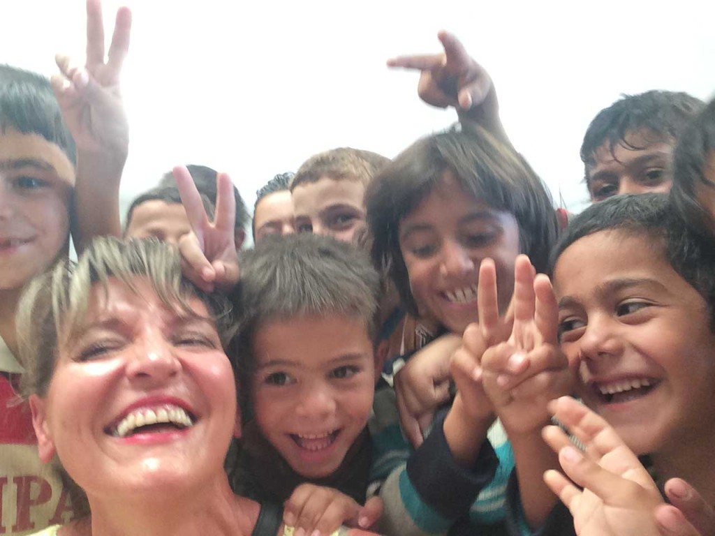 Martina Anderson pictured with children in the Zaateri camp