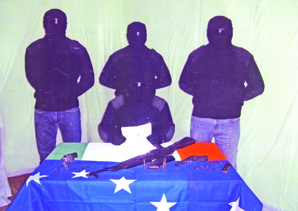 Members of the new group with weapons – one of the flags on the table is the Starry Plough as it's believed the gang has ties to the INLA