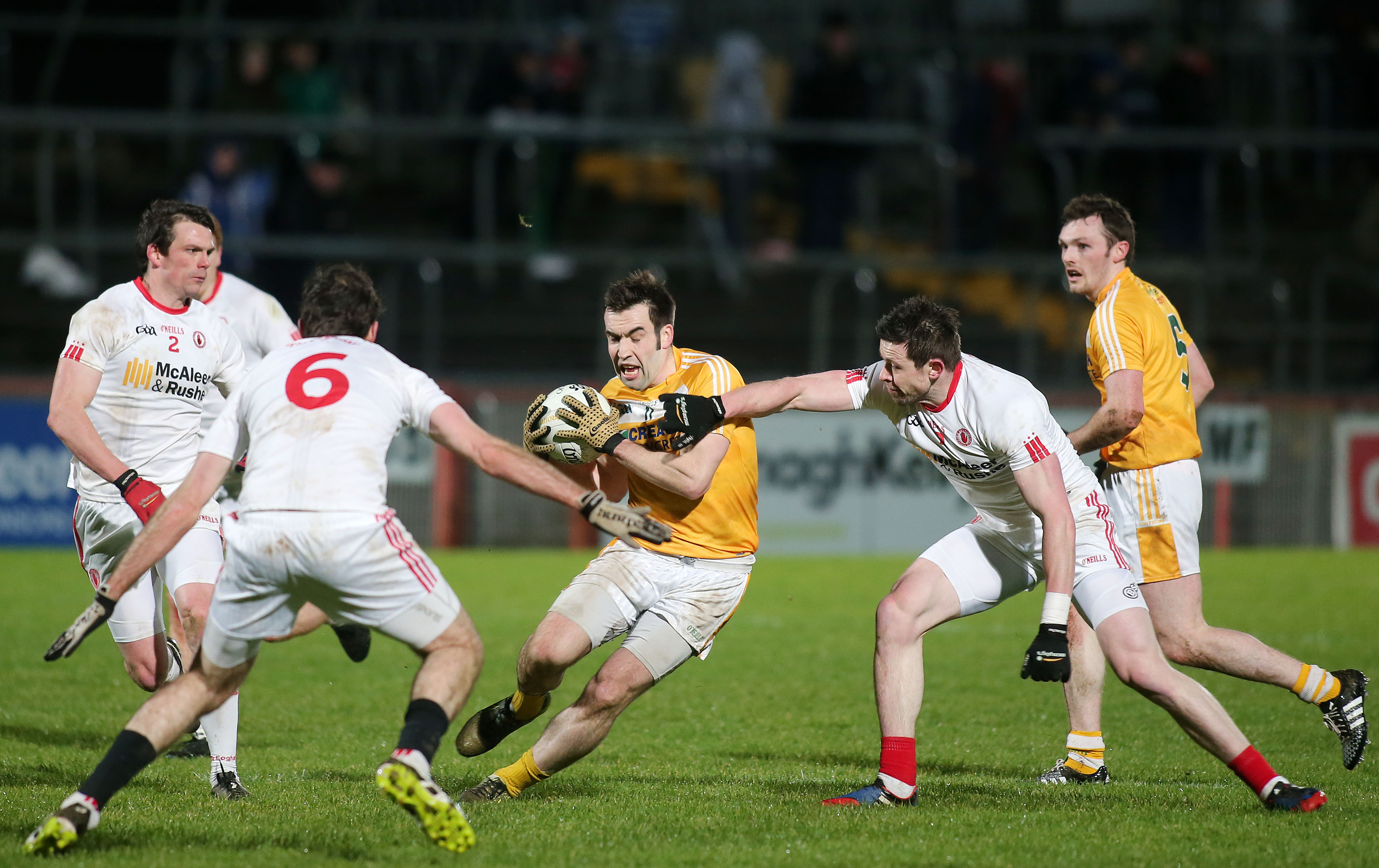 Antrims kevin niblock pushes forward against tyrones justin mahon and conor clarke copy1