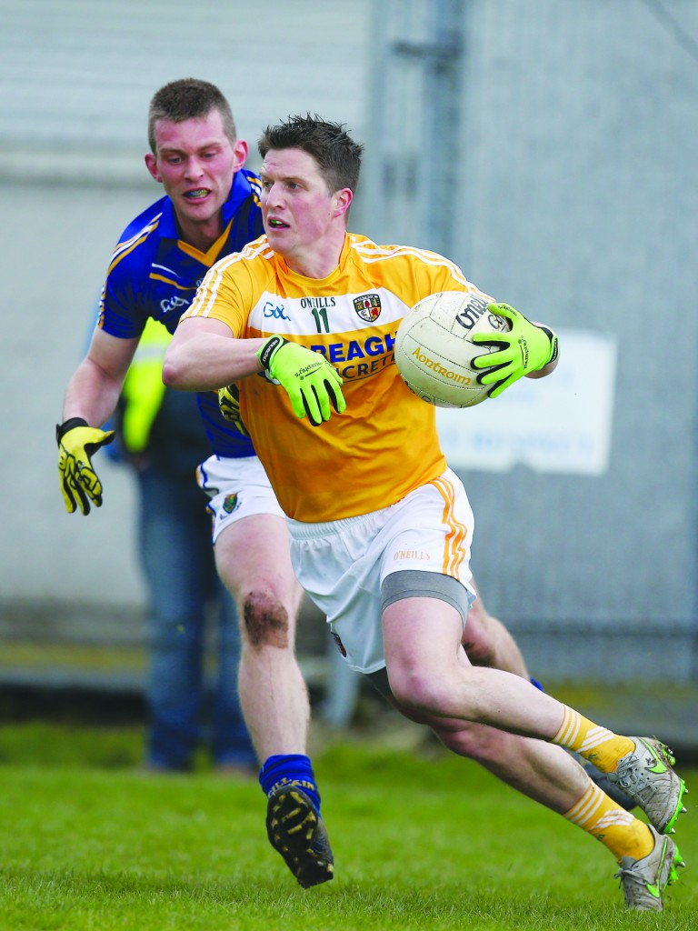 Tomas McCann in action against Wicklow last week. The Cargin ace bagged Antrim's first goal as the Saffrons clinched promotion with a four-point win in Aughrim.