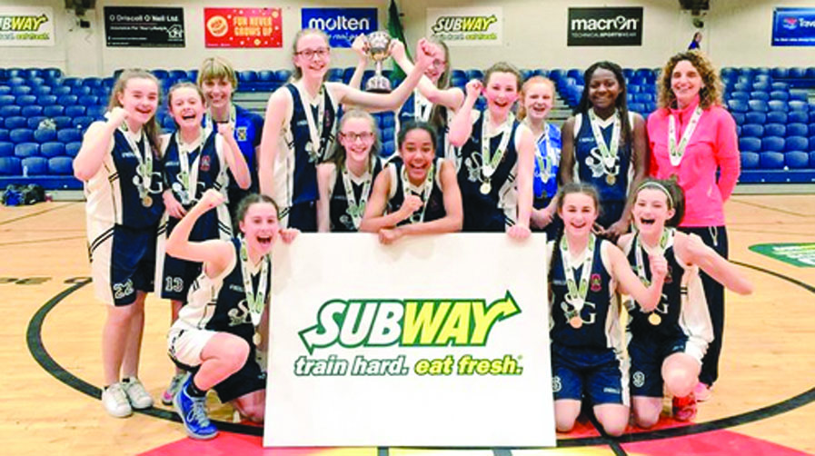 St Genevieve's Girls celebrate their All-Ireland Schools U15B Girls Cup success following a 43-31 victory in the final against Pobalscoil Chorca Dhuibhne
