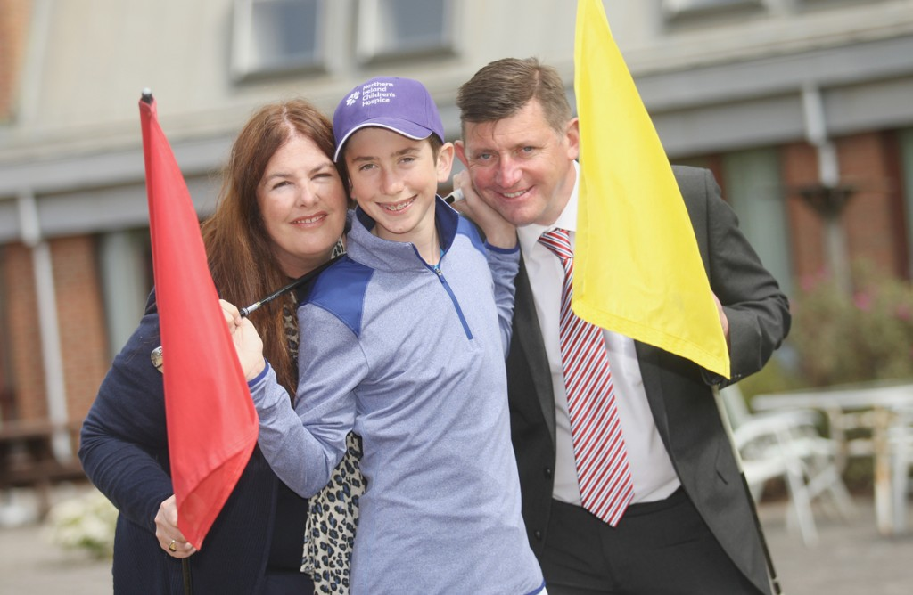 FLYING THE FLAG: Sara and Robin McKibbin with son Tom, the new Children's Hospice Ambassador