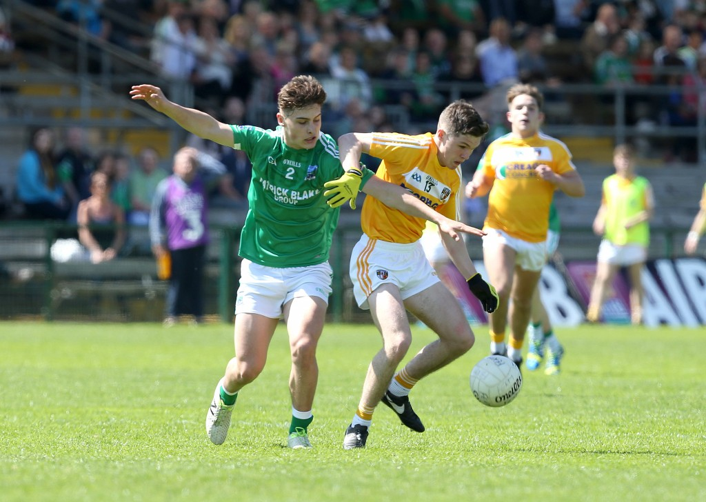 Fermanagh's Johnny Cassidy and Antrim's Liam Quinn battle for possession during Sunday's Ulster Minor Football Championship clash in Brewster Park