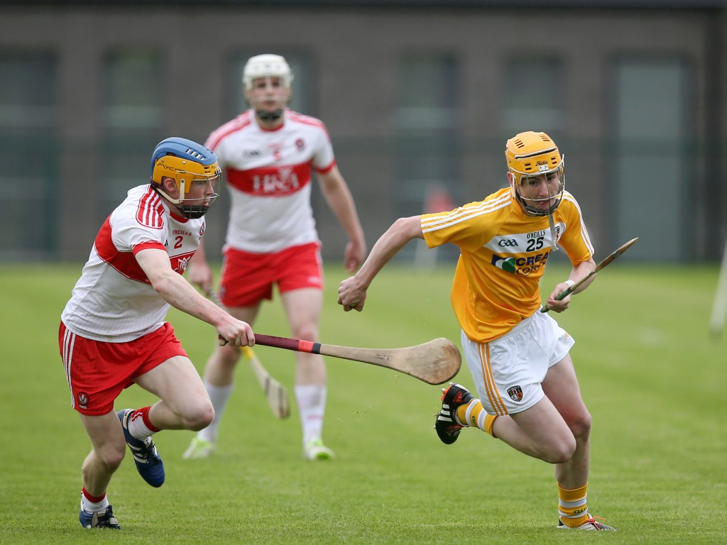Peter McCallin tries to break away from the challenge of Derry's Ruairi McWilliams during Sunday's game at Owenbeg