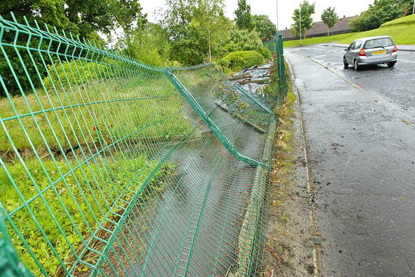 The damage caused to the Poleglass community garden exterior fence