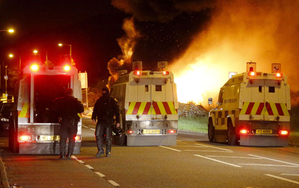 PSNI riot squad face off with a gang of loyalists Credit - Kevin Scott