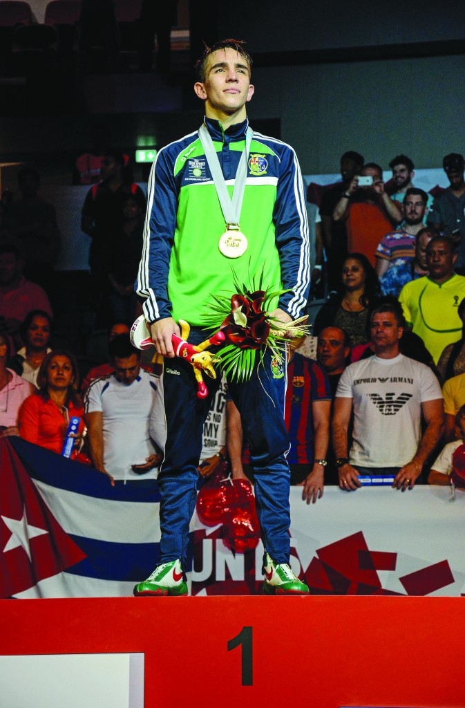 Michael Conlan stands proudly after being crowned world champion last year. Having also won gold at the European Championships and Commonwealth Games, he is confident he can complete the set and add to his bronze from London
