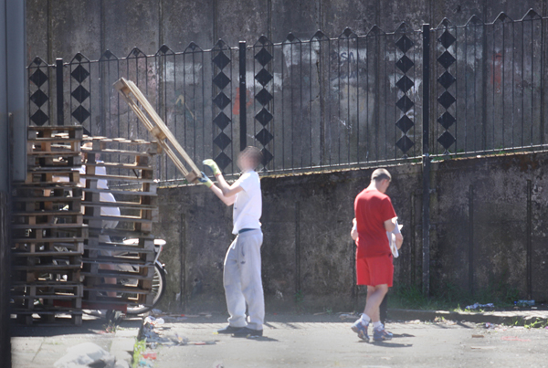 Bonfire builders stack pallets in the New Lodge ahead of Monday night's planned fire which is opposed by a majority of local residents