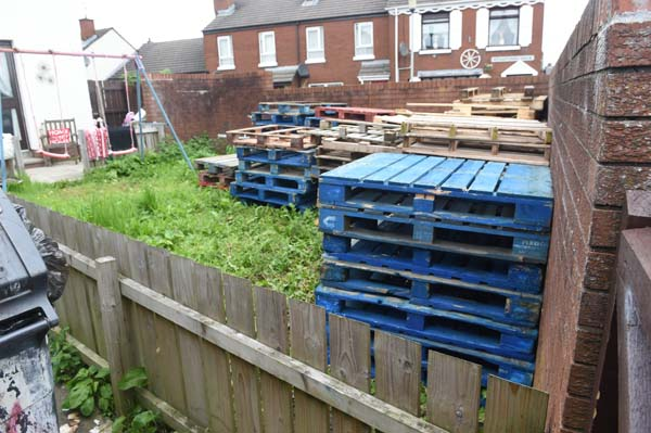 The pallets stored in an Oldpark garden have now been removed