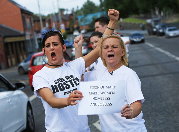 Residents of Regina Coeli House voice their opposition to closure at a protest on Monday.