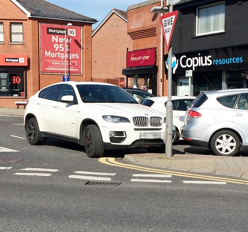 TIGHT SPOT: This BMW 4X4 was imaginatively parked in Glengormley; above left, no way out