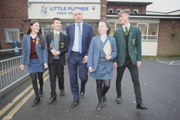Claire Maitland, Filip Skalbania, Ellie Bywater and Pearse Hull with Trinity College Principal Jim McKeever