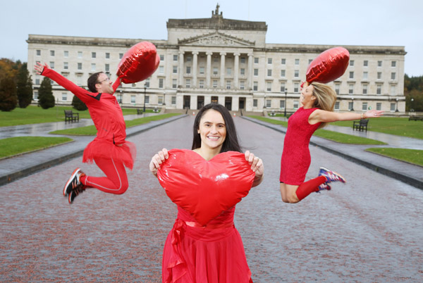 ON YOUR MARKS: Gillian Abraham (centre), who lost her father to heart disease, is joined by teammates Sonia Morgan and Paul McCrory who are the first to sign up for the Red Dress Run