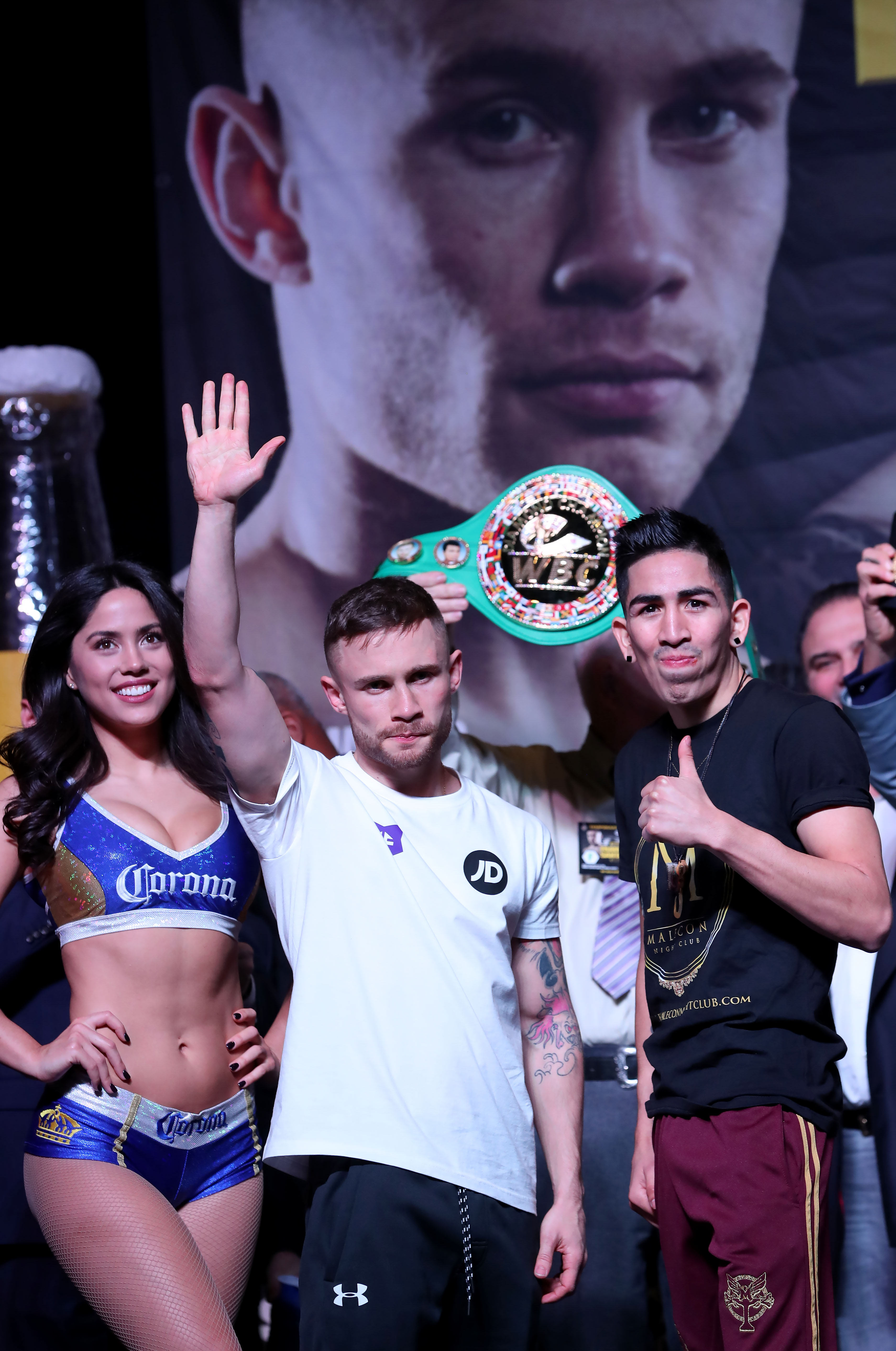 Carl Frampton and Leo Santa Cruz salute the fans at yesterday\'s weigh-in Photo William Cherry/Presseye
