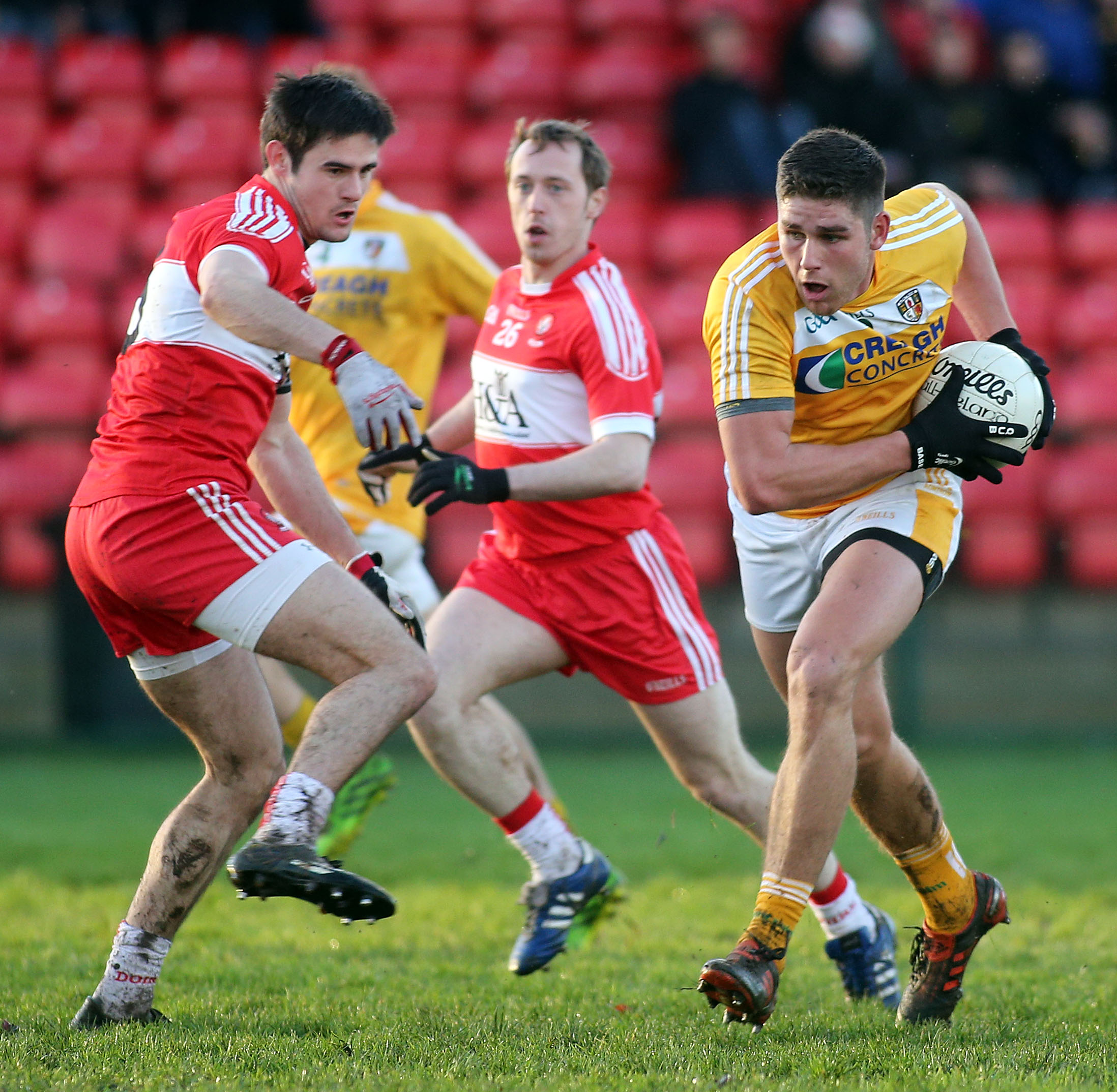 Antrim's Jack Dowling, pictured in action against Derry's Chrissy McKaigue, is hoping to nail down a starting slot for the Saffrons this year and is hoping to help his side claim their first league points this Sunday when they host Sligo in Corrigan Park