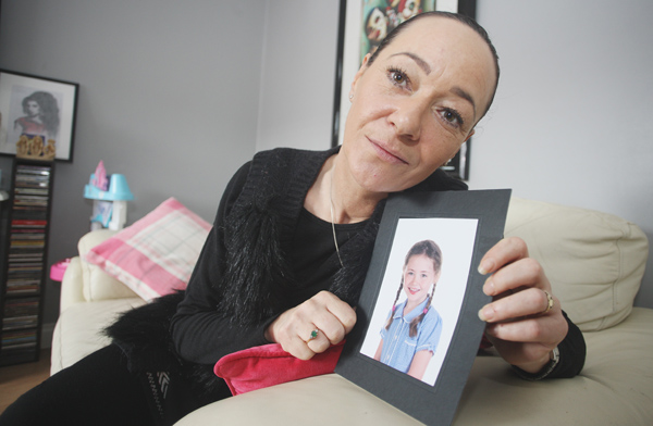DETERMINED: Kellie McConville at her  Lagmore home with a picture of her daughter Mia