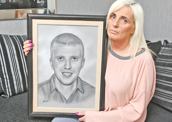 Tracy Carnahan with a treasured portrait of her son Sean Paul
