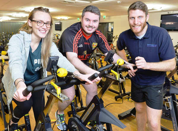 Fitness enthusiasts Catriona McGrattan and Daniel Higgins (centre) get to grips with the new Pulse Group spin bikes at the Shaftesbury Community and Recreation Centre in South Belfast with staff member Gerard Walls