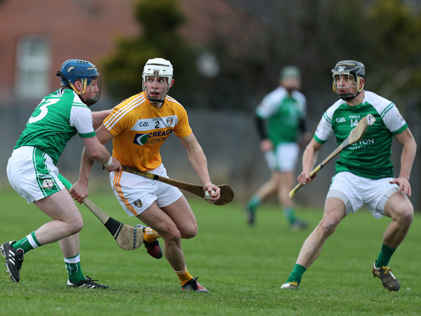 Antrim's Stephen Rooney in possession against London's Adam Murphy during yesterday's NHL Division 2A clash in Corrigan Park