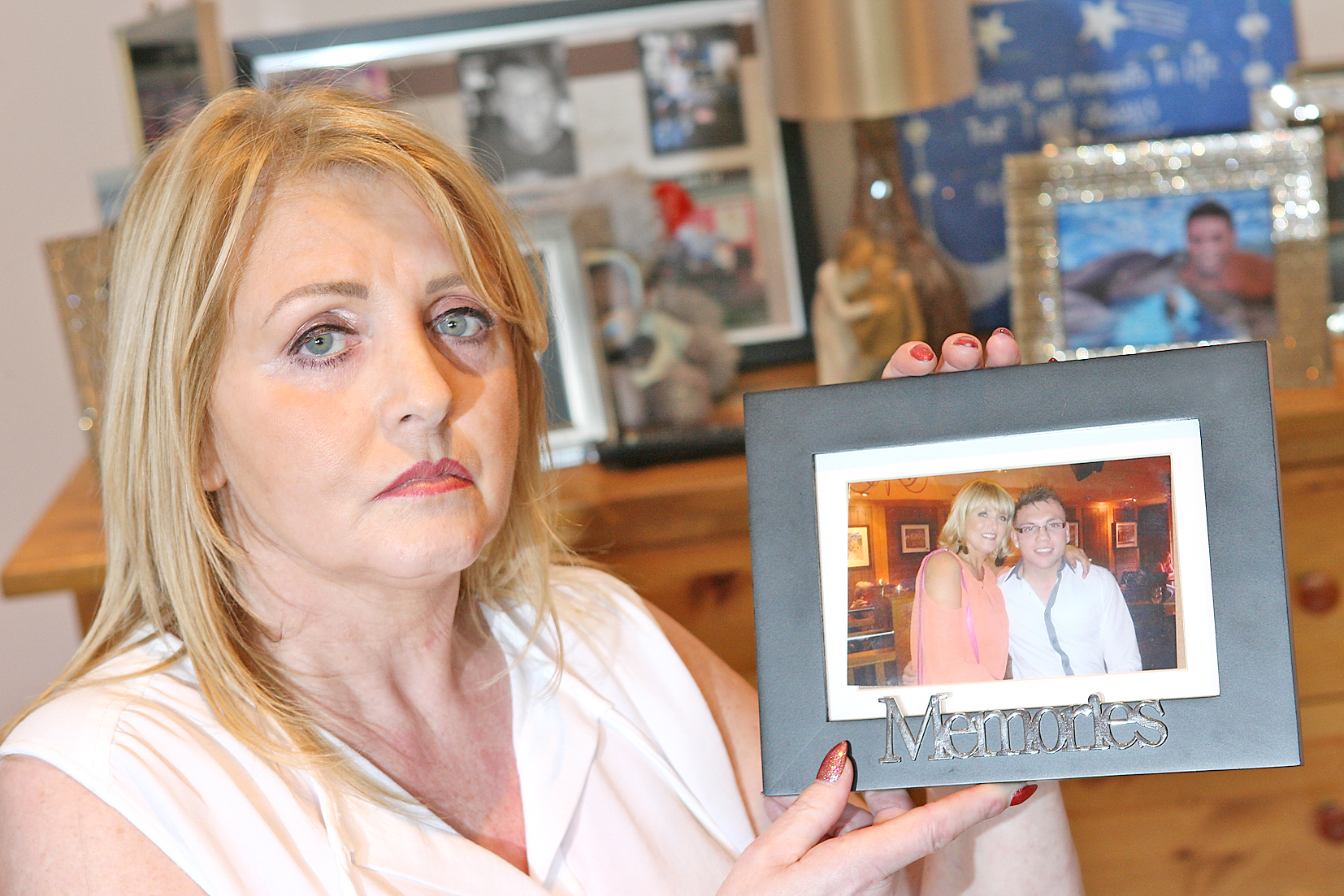 Mary Magee holds a photograph of herself and her son Eamonn