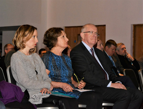 TOGETHER:Pat Finucane\'s daughter Katherine and wife Geraldine sit with Irish Minister for Foreign Affairs Charlie Flanagan at the Pat Finucane Lecture held in the Europa Hotel   pic by @antrimlens