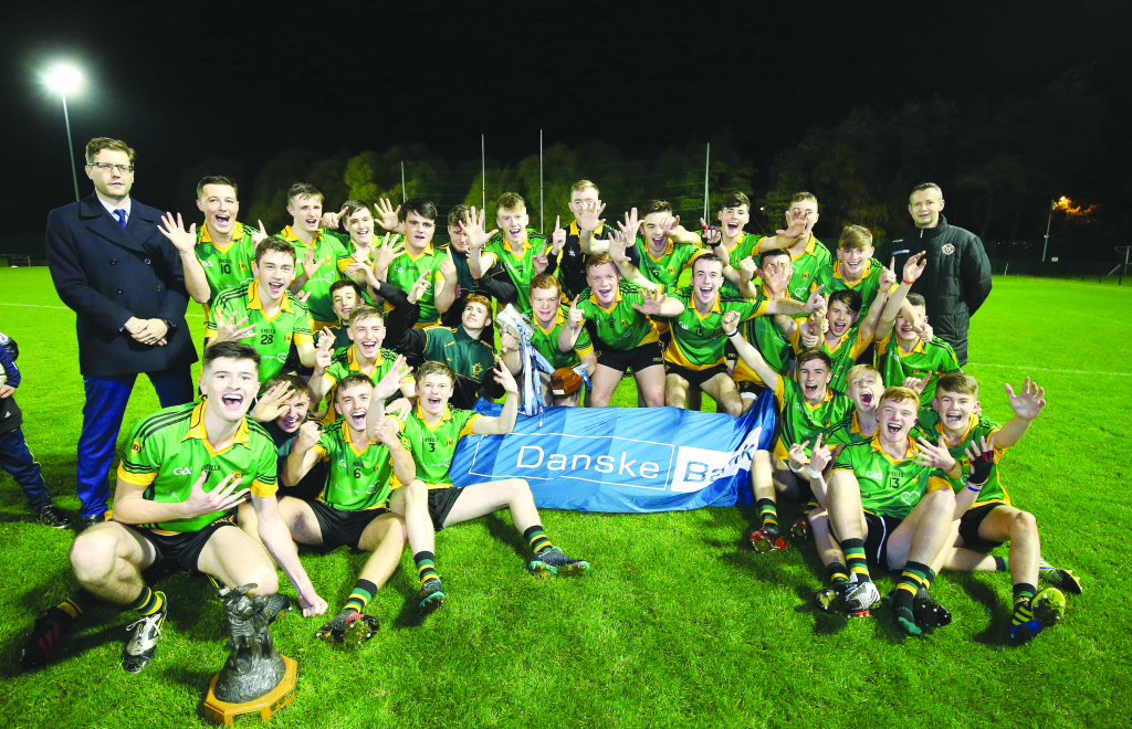 The St Mary's players celebrate their Mageean Cup win