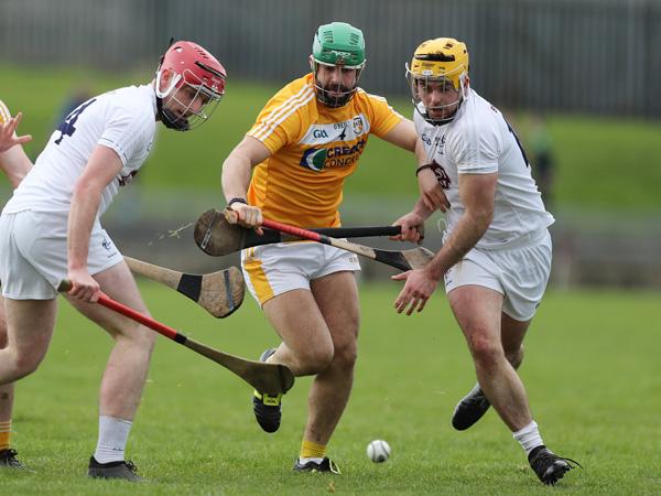 Antrim\'s Ciaran Johnston in action against Kildare\'s Mark Dleaney and Chris Bonus