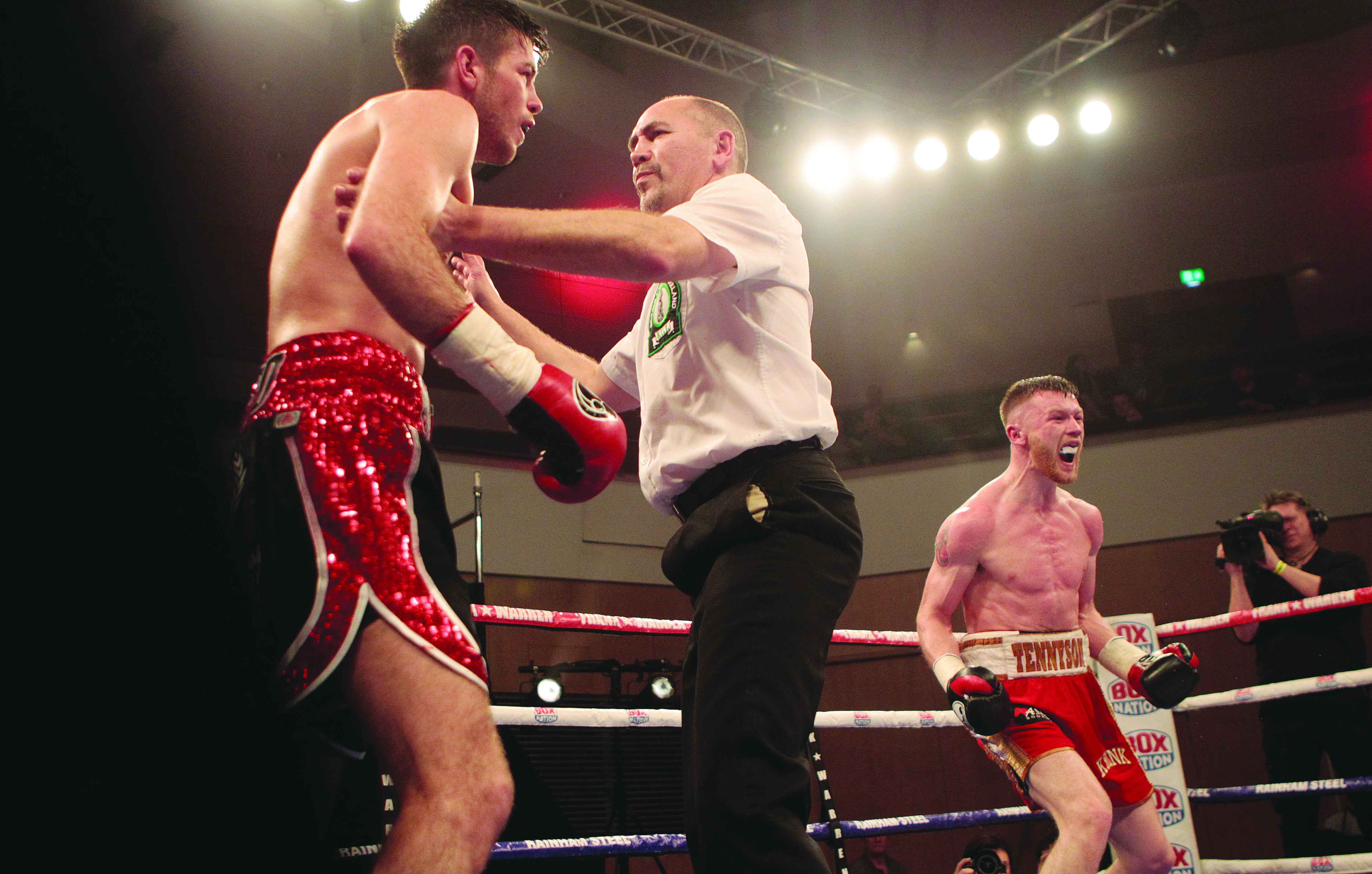 James Tennyson can't hide his delight as referee David Irving waves off Friday's Irish super-featherweight title fight against Declan Geraghty