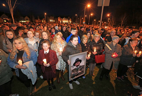The front of the large crowd at the West Belfast tribute