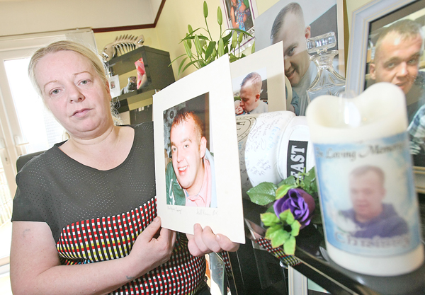 TRAGEDY: Patricia Browne surrounded by treasured portraits of her son Christopher Lavery – she says her son met his dealer on the Dublin Road hours before his death