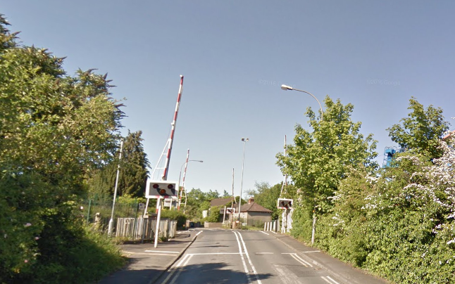 Youths were seen running across the train tracks at Dunmurry on Thursday evening