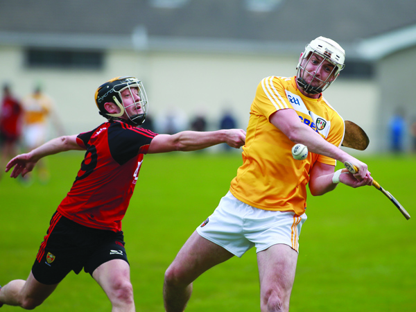 Antrim\'s Conor McKinley is chased by Down\'s Scott Nicholson during the meeting between the side's three weeks ago