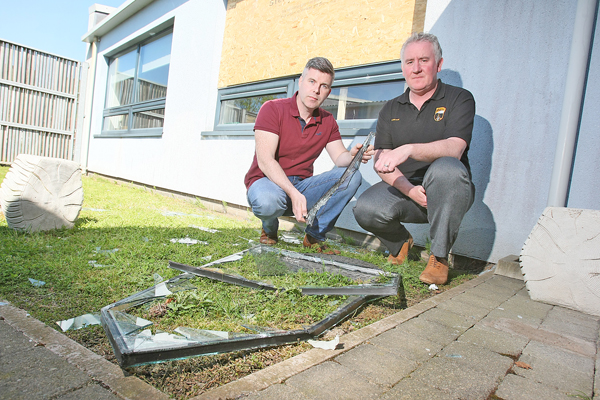 AFTERMATH: Pilib Misteil, Bunscoil an tSleibhe Dhuibh Principal, surveying the damage at the school with Councillor Steven Corr