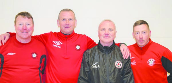 Sport and Leisure boss Packie McAllister (second from left) and his backroom team endured a 'frustrating season' but maintained their Premier Intermediate League status on the final day