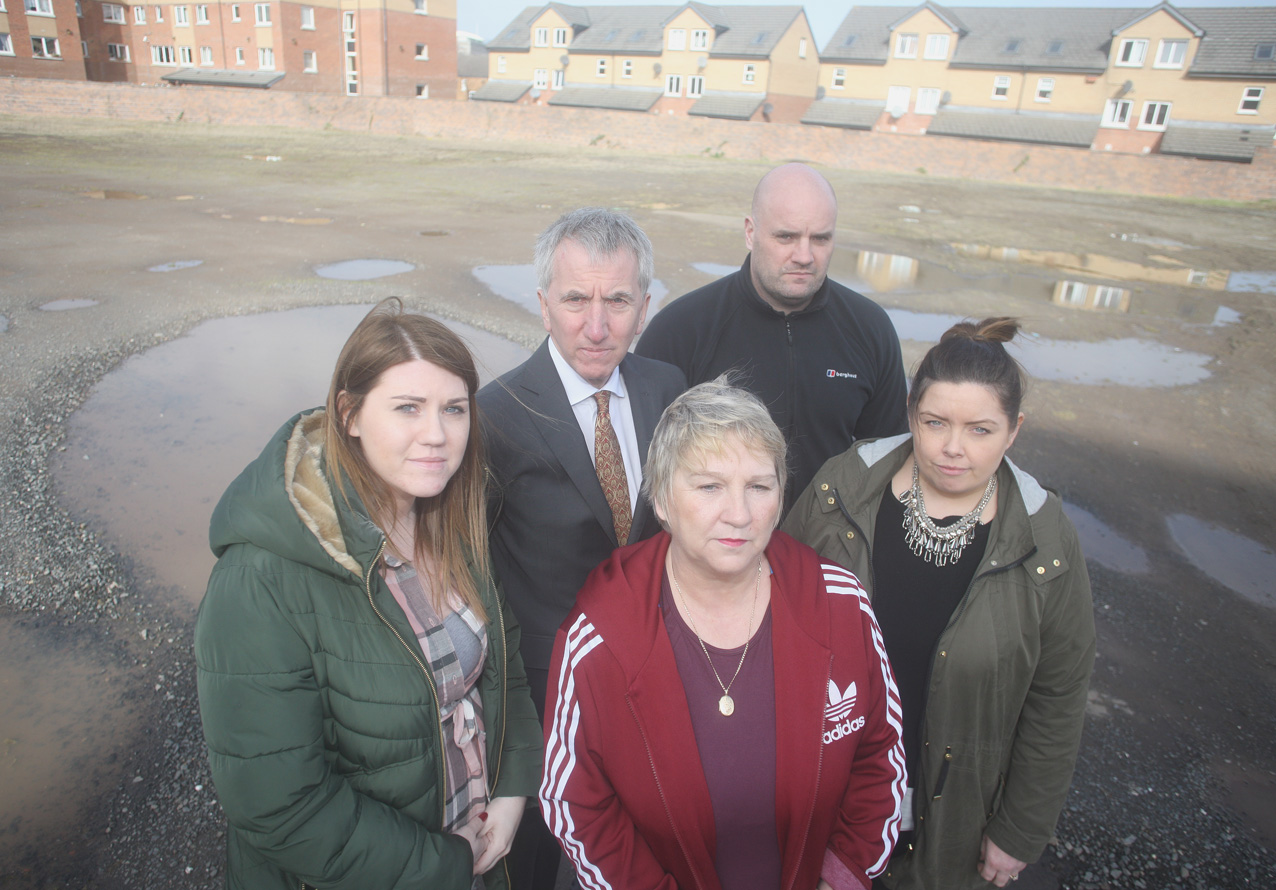 Markets community workers Kathleen McCarthy and Niall Houston (left and fourth left), resident Bernie Davison (front), Máirtín Ó Muilleoir MLA and Cllr Deirdre Hargey at the Gasworks site where there are plans to expand the Radisson Blu