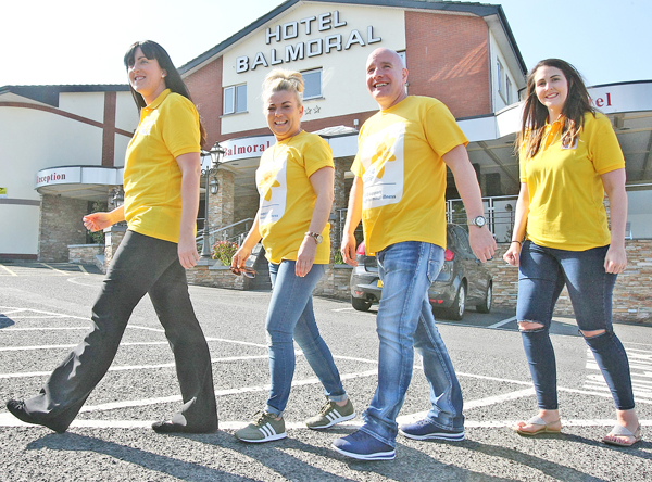 STEPPING OUT:Marie Therese Morgan, Sharon Fennell, Mark McCabe and Grace Smyth gear up for the charity walk which is taking place this Saturday morning on Divis Mountain