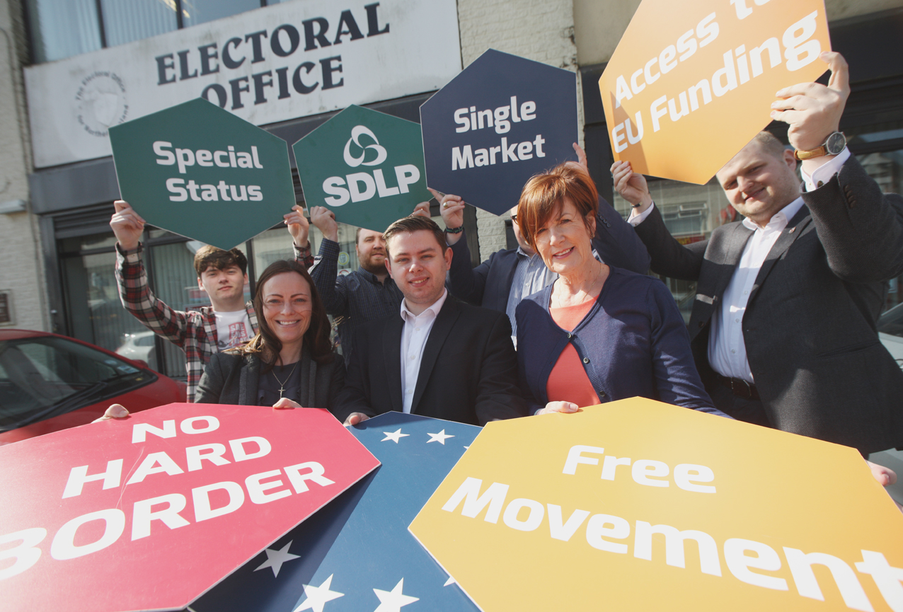 Martin McAuly with supporters Noreen McClelland and Nichola Mallon