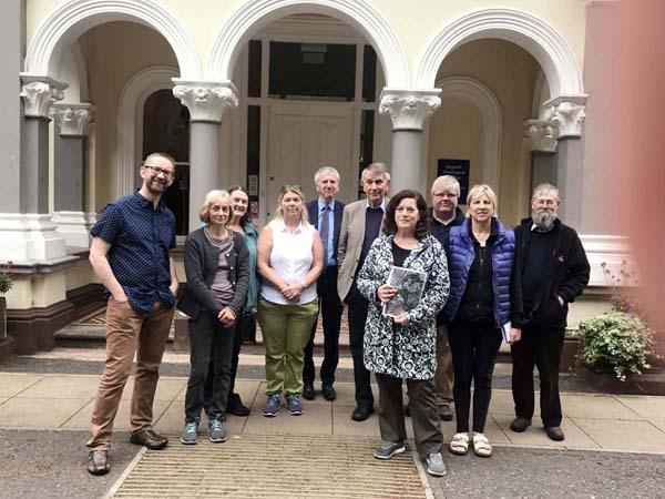 Máirtín Ó Muilleoir and Geraldine McAteer with members of the Sans Souci Residents' Committee