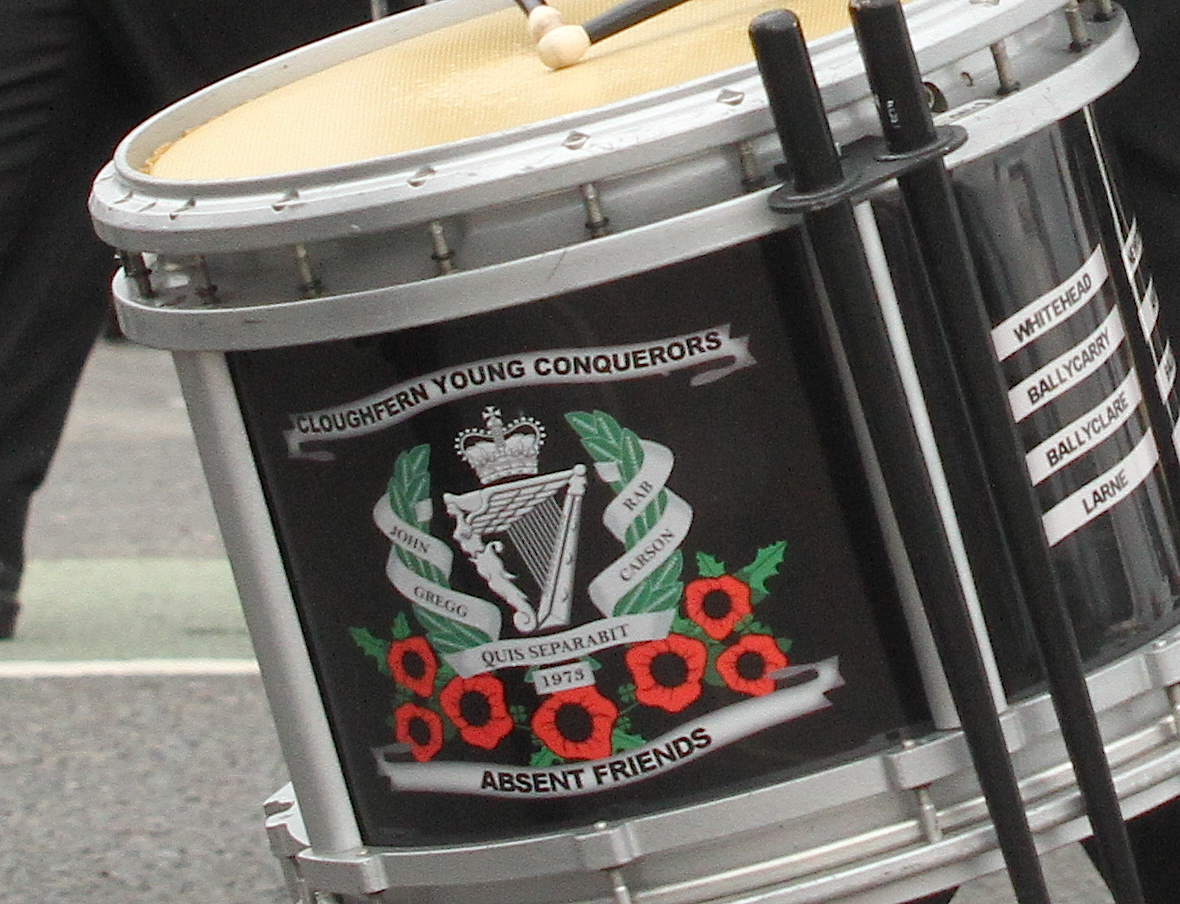 The names of UDAleaders John Gregg and Rab Carson, which adorned the drums and uniforms of the Cloughfern Young Conquerors band in 2015