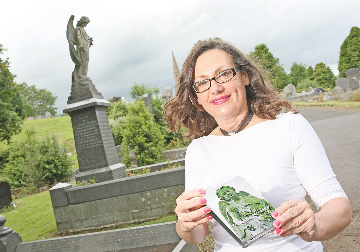 Deirdre Mackel at City Cemetery with Tom Hartleys book, Written in Stone.