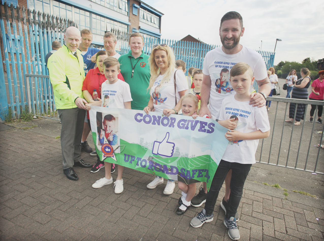 Holy Cross principal Kevin McArevey with Conor O\'Neill's parents Ciara and Kevin, brother Kevin and sister Cara Rose
