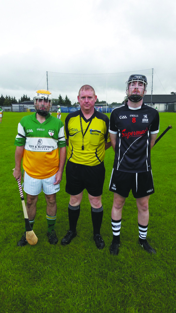 Davitt's captain Canice Mooney and St Agnes' captain Ronan Carroll pictured with match referee Eamon Hamill (St Teresa's) before last night's Junior B Hurling Championship semi-final at McDonnell/Doherty Park. The Davitt's emerged with a two-point win to book their place in Sunday's final against Ballymena