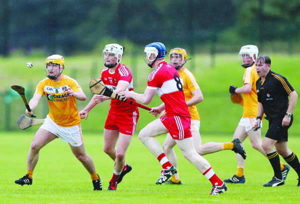 Antrim's Michael McGreevy gets away from Derry duo Eoghan O'Kane and Martin Quinn during the Ulster final at Owenbeg. The provincial champions return to action on Saturday when they take on Dublin in the All-Ireland quarter-final in Newry